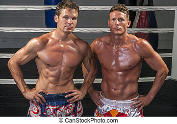 Muay Thai match - Two Caucasian Muay Thai fighters pose...