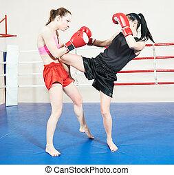 Muay thai woman fighting at boxing ring - Thai kickboxing...