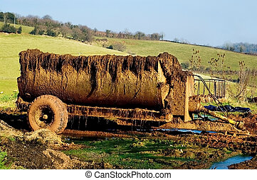 Muck Spreader used in agriculture for spreading silage.