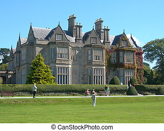 Muckross House, Victorian mansion, in Killarney, County Kerry, Ireland. Building commenced in 1839 and was completed in 1843. It is amongst one of the most visited tourist attractions in Ireland. Muckross House belongs to the Nation since 1932 and was opened to the public in the mid 1960s.