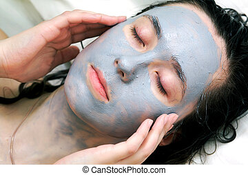 Mud mask on face