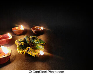 Mud or Clay Diya oil lamp Arranged on Black background used for decoration in diwali festival , selective focus