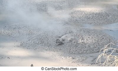 Mud Pools with boiling liquid, natural geothermal valley. Slow motion