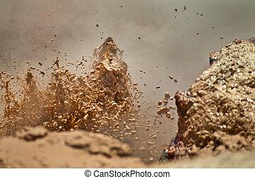 Mud Volcano - Close-up shot of a erupting mud volcano in ...