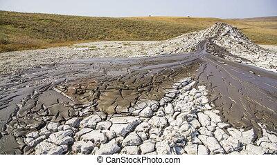 Mud Volcano Streams. - Panning shot of streams of flowing...