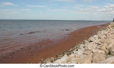 Evangeline Beach - Muddy beach water of Evangeline Beach,...