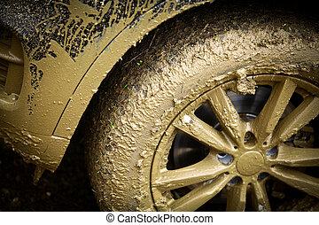 Muddy car's wheel - Color detail shot of an off-road car's...