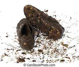 Muddy football shoes after the game - Muddy and dirty...