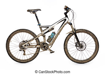 Muddy mountain bike isolated on white background