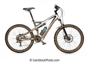 Muddy mountain bike isolated on white background