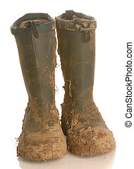muddy rubber boots isolated on white background