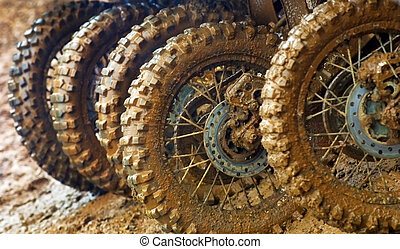 Muddy tires of motocross racers.