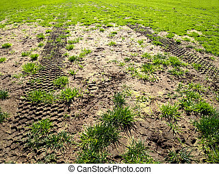 muddy tracks - tyre tracks on a muddy sports field