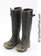 Green muddy wellies