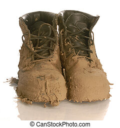 muddy work boots isolated on a white background