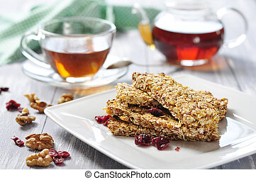 Muesli Bars on plate with nuts and dried fruits