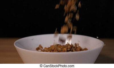 Muesli falling into a bowl