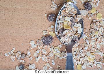 Muesli in stainless steel spoon