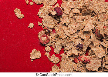 Muesli on a red plate