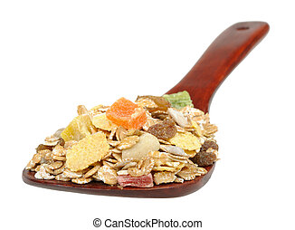 muesli on a wooden spoon