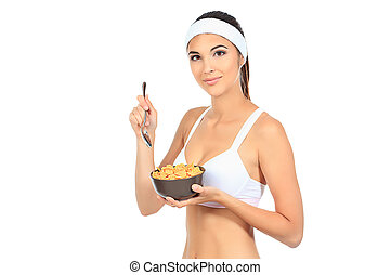 muesli - Portrait of a beautiful young woman eating cereal....