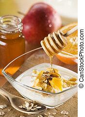 muesli with milk honey and fruit close up
