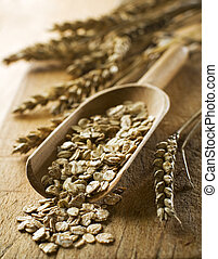 muesli flakes in a wooden spoon close up