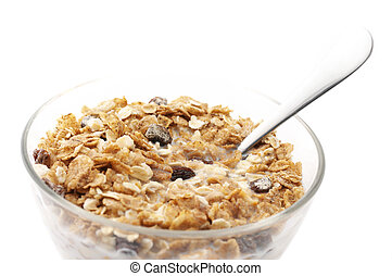Muesli with milk in glass bowl isolated on white background.