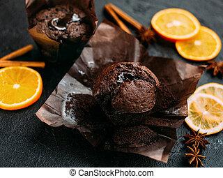 Muffin chocolate on a dark background