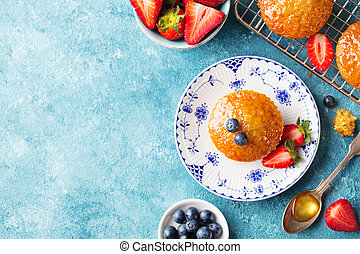 Muffin, cupcake with berries Top view. Copy space