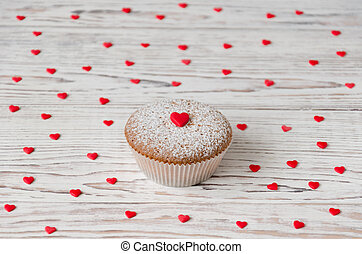 Muffin decorated with red hearts