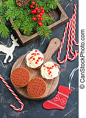 muffins and christmas decoration on a table