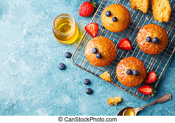 Muffins, cakes with berries Top view. Copy space