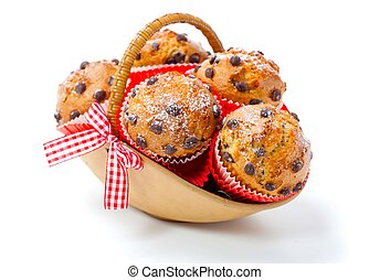 Muffins in a basket isolated on white background