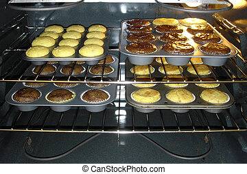 Muffins in the Oven - Trays with Almost Ready Muffins in the...