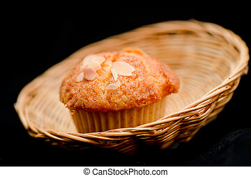 Muffins with almond on top in the basket