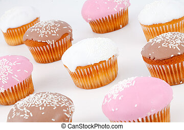 Muffins with icing sugar against a white background
