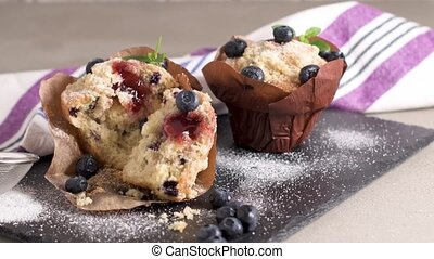 Muffins with red fruits jam fill