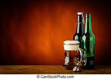 Mug and bottles of beer