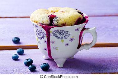 mug cake prepared in microwave . horizontal permission. selective focus