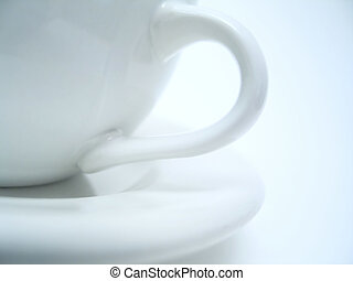 Mug Handle - Close up of a mug handle and a saucer.