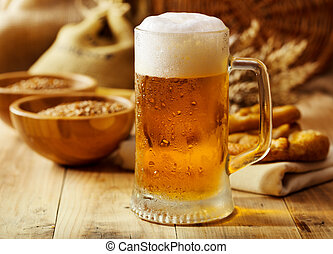 mug of beer on wooden table