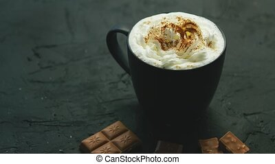 Mug of cacao with whipped cream - Closeup of black mug with...