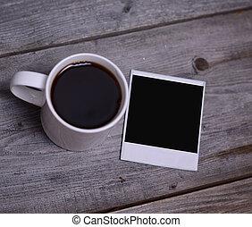 Mug of coffee with photo paper
