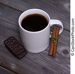 Mug of coffeek with cinnamon and chocolate