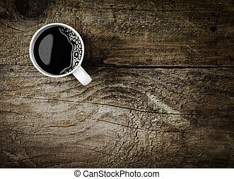 Mug of espresso coffee on rustic wood