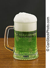 beer - Mug of green beer on wooden counter