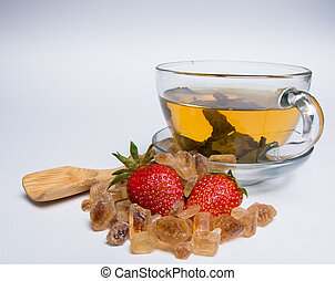 mug of green tea with fresh red strawberries