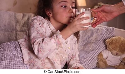 Mug of milk - Little girl drinking milk before go to sleep