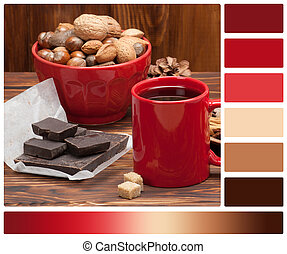 Mug Of Tea Or Coffee. Sweets And Spices. Bowl Of Nuts. Christmas Decorations. Wooden Background. Palette With Complimentary Colour Swatches